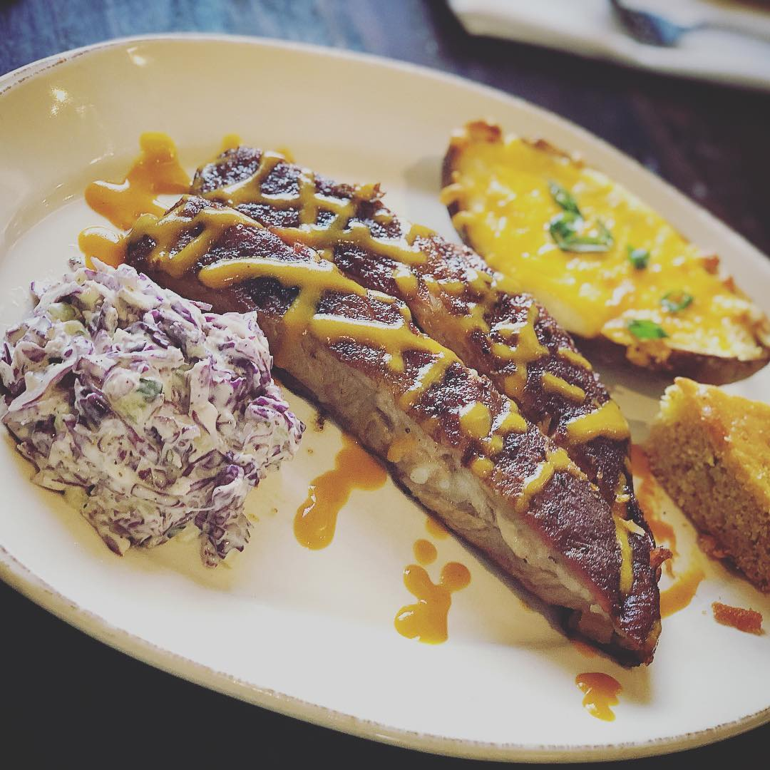 Smoked Spareribs with red cabbage slaw and twice baked potato!…